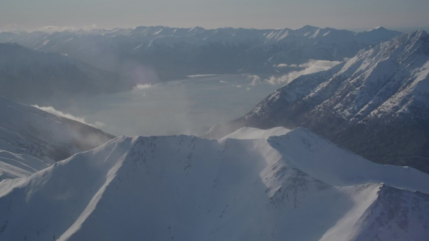 4K stock footage aerial video snowy Kenai Mountains across Turnagain Arm of the Cook Inlet, Alaska Aerial Stock Footage | AK0001_1983