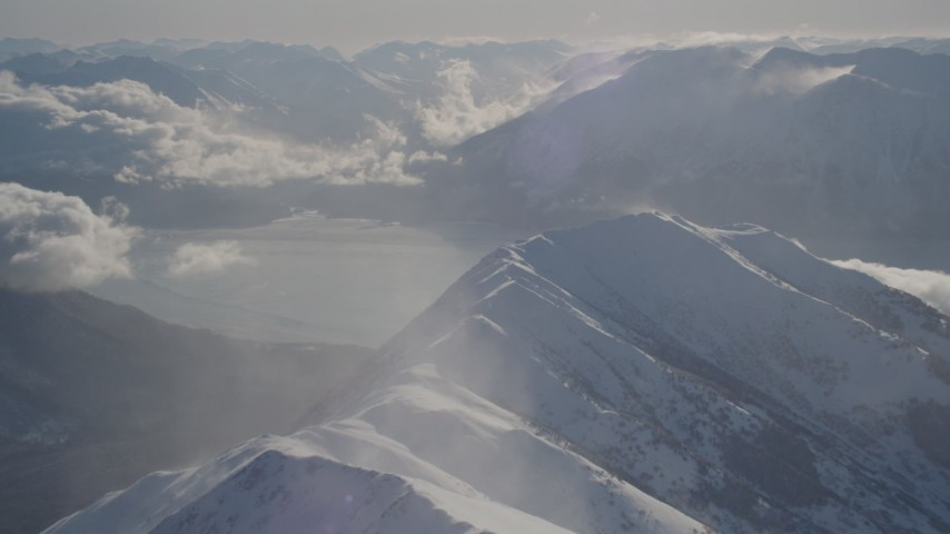 4K stock footage aerial video snowy Kenai Mountains across the Turnagain Arm of the Cook Inlet, Alaska Aerial Stock Footage | AK0001_1984