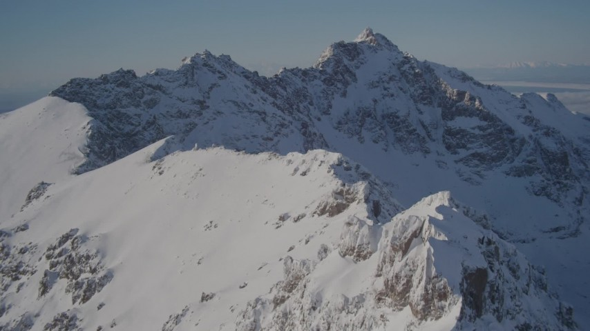 4K stock footage aerial video flying over the snow covered Chugach Mountains, Alaska Aerial Stock Footage   AK0001_1990