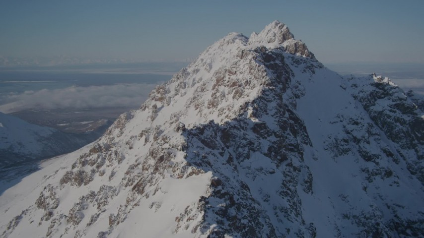 4K stock footage aerial video flying toward the snowy summit of a peak in the Chugach Mountains, Alaska Aerial Stock Footage | AK0001_1992