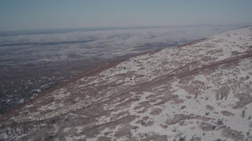 4K stock footage aerial video flying near a snowy mountain slope in the Chugach Mountains, Alaska Aerial Stock Footage | AK0001_2004