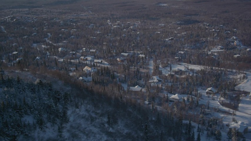 4K stock footage aerial video flying by a residential neighborhood in Anchorage, Alaska in snow Aerial Stock Footage | AK0001_2006