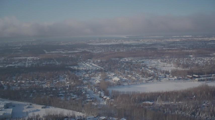 4K stock footage aerial video fly over snowy residential neighborhoods toward downtown Anchorage, Alaska Aerial Stock Footage | AK0001_2009