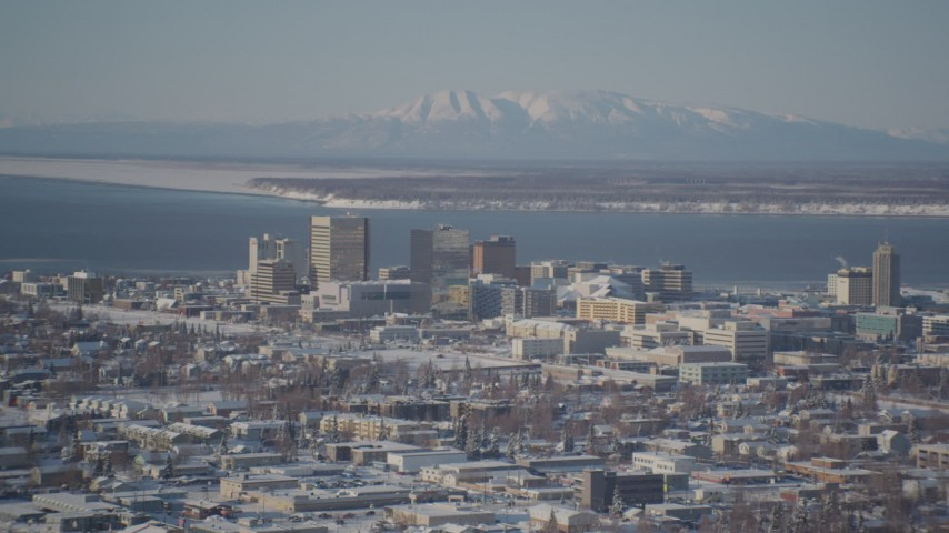 4K stock footage aerial video flying toward snowy Downtown Anchorage, Knik Arm of the Cook Inlet, Alaska Aerial Stock Footage | AK0001_2012