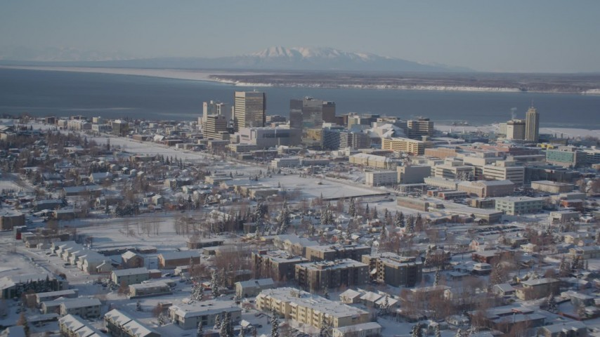 4K stock footage aerial video flying over snowy residential buildings toward Downtown Anchorage, Alaska Aerial Stock Footage | AK0001_2013
