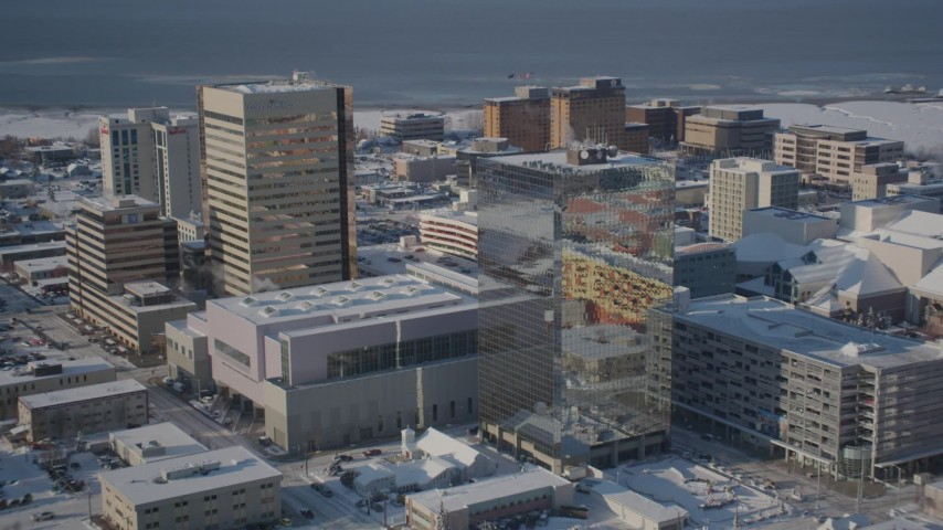 4K stock footage aerial videos tilting down on snow covered buildings in Downtown Anchorage, Alaska Aerial Stock Footage | AK0001_2014