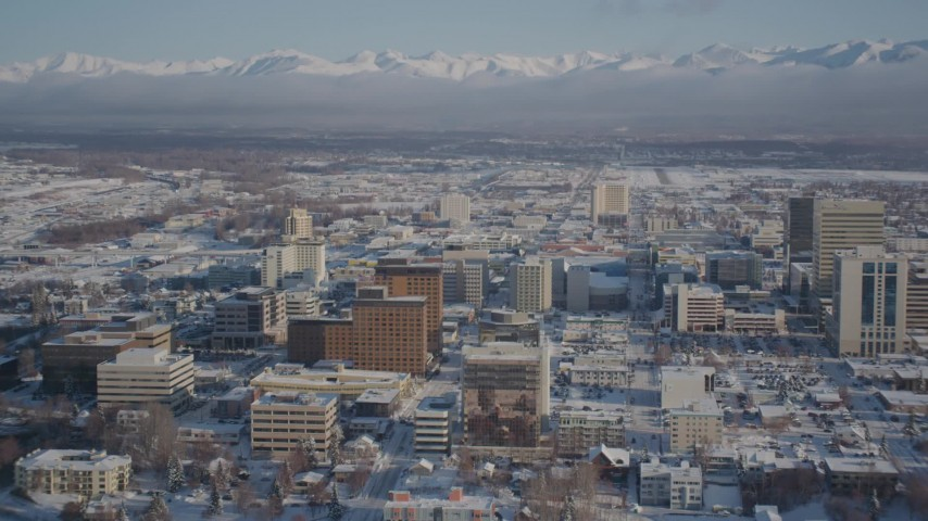 4K stock footage aerial video tilt up from Knik Arm of the Cook Inlet to snowy Downtown Anchorage, Alaska Aerial Stock Footage | AK0001_2018