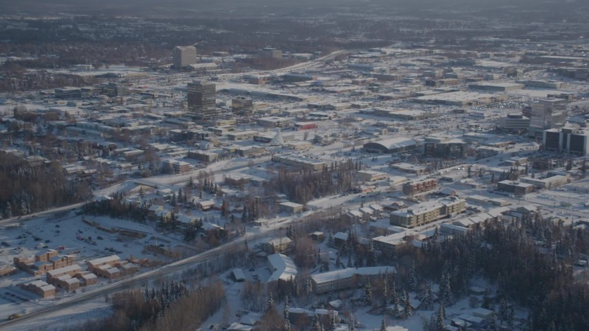 4K stock footage aerial video panning across snow covered residential neighborhoods, Anchorage, Alaska Aerial Stock Footage | AK0001_2025
