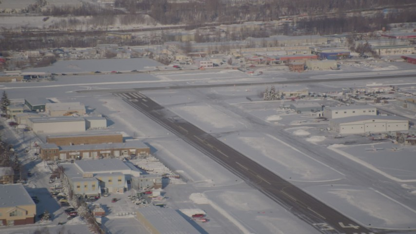 4K stock footage aerial video a small airplane taking off from snow covered Merrill Field, Anchorage, Alaska Aerial Stock Footage   AK0001_2027