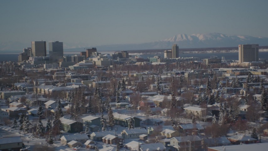 4K stock footage aerial video Downtown Anchorage beyond snow covered residential neighborhoods, Alaska Aerial Stock Footage | AK0001_2028