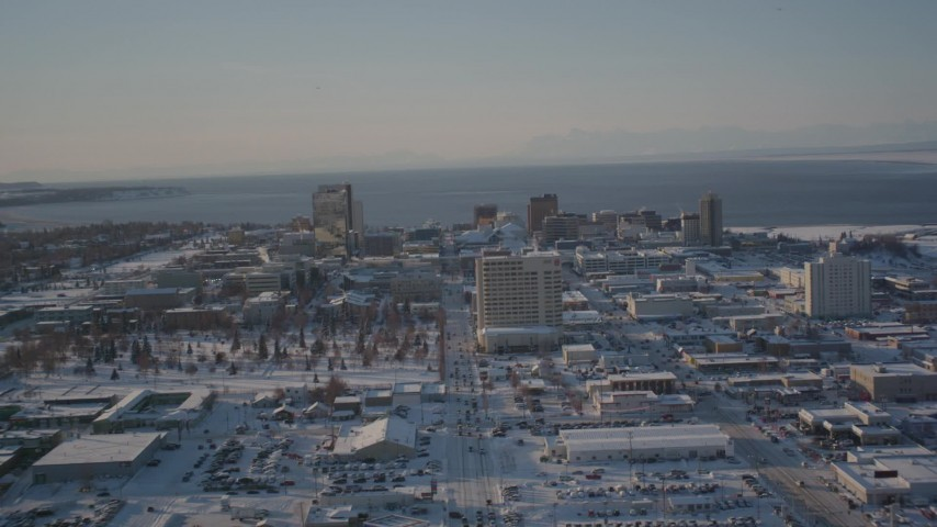 4K stock footage aerial video ascending over buildings in snow covered Downtown Anchorage, Alaska Aerial Stock Footage | AK0001_2029