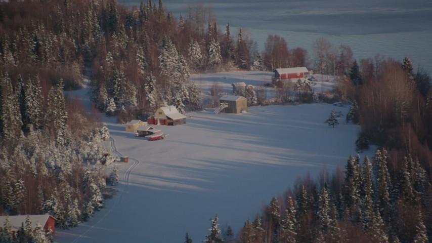 4K stock footage aerial video cabins in snowy woods in Point MacKenzie, Alaska Aerial Stock Footage   AK0001_2034