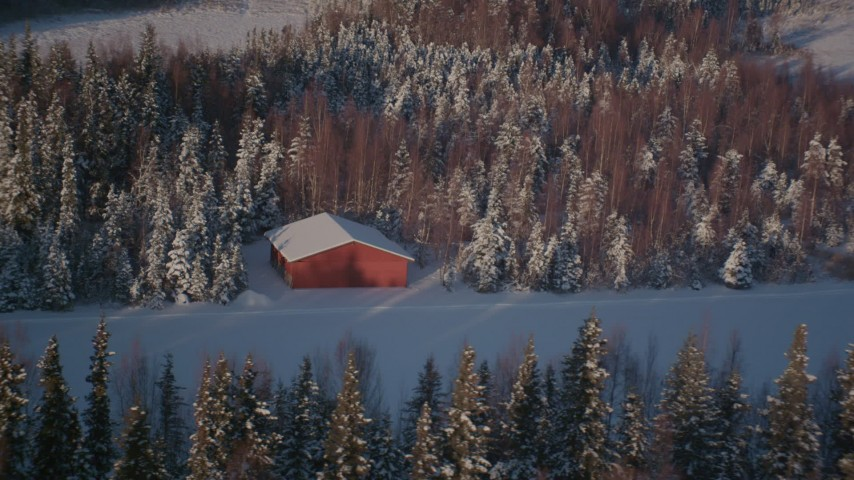 4K stock footage aerial video flying away from a small cabin on a snowy road in Point MacKenzie, Alaska Aerial Stock Footage | AK0001_2035