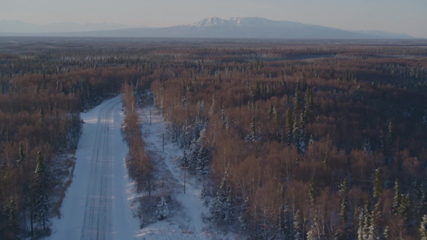 4K stock footage aerial video following a deserted snowy rural highway in Point MacKenzie, Alaska Aerial Stock Footage | AK0001_2045