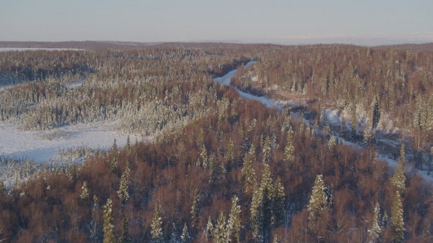 4K stock footage aerial video flying toward a deserted, snowy rural highway in Point MacKenzie, Alaska Aerial Stock Footage | AK0001_2048