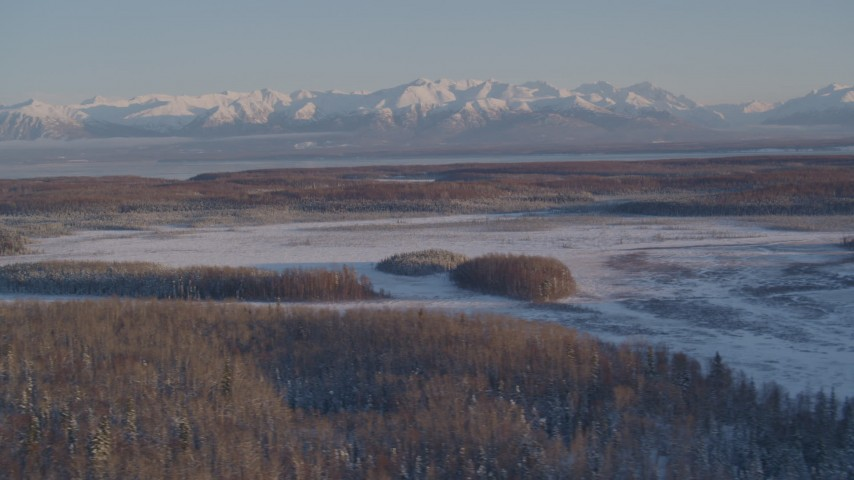 4K stock footage aerial video snowy Chugach Mountains, woods, Big Lake Area, Knik-Fairview, Alaska Aerial Stock Footage | AK0001_2059