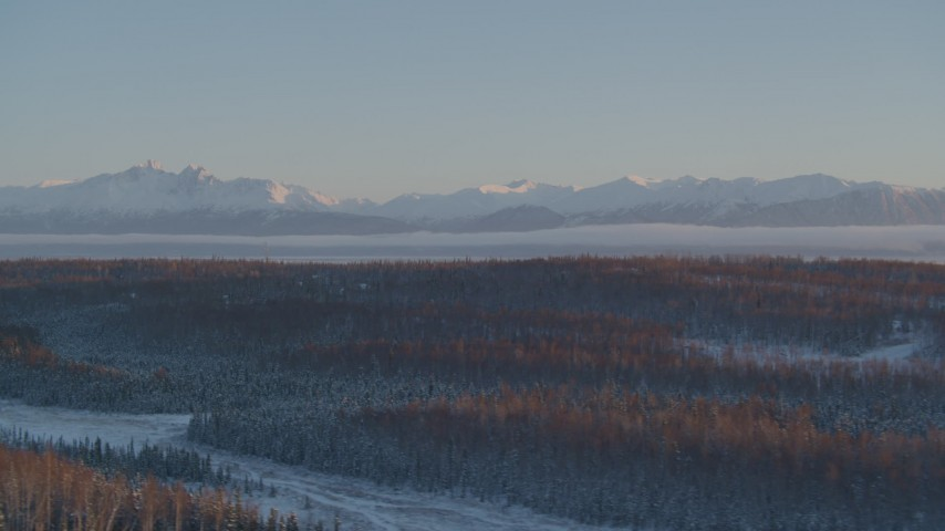 4K aerial video snow covered Chugach Mountains seen from Wasilla at sunset, Alaska Aerial Stock Footage | AK0001_2075