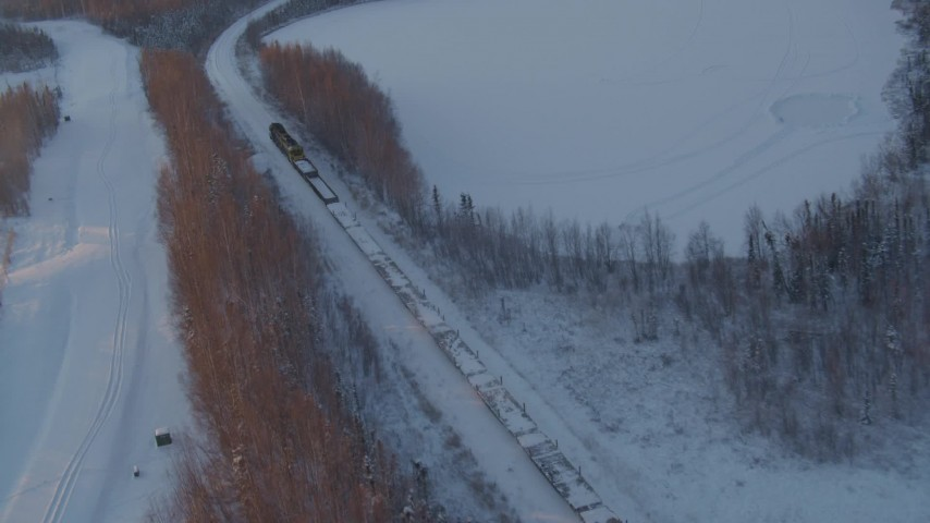 4K stock footage aerial video a snow covered train running by Jacobsen Lake at sunset, Wasilla, Alaska Aerial Stock Footage | AK0001_2080