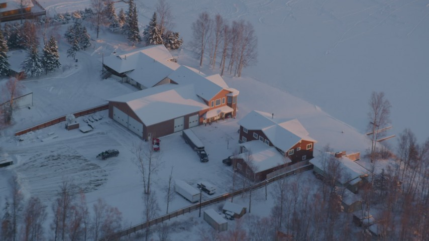 4K stock footage aerial video orbiting a snow covered house on Lucile Lake at sunset, Wasilla, Alaska Aerial Stock Footage | AK0001_2085