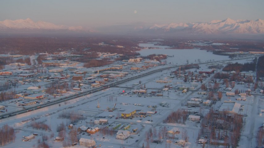 4K stock footage aerial video Lucile Lake toward Wasilla Lake with snow on the ground at twilight, Alaska Aerial Stock Footage | AK0001_2087