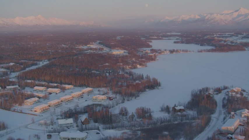 4K stock footage aerial video flying over snow covered Wasilla near Wasilla Lake at sunset, Alaska Aerial Stock Footage | AK0001_2088