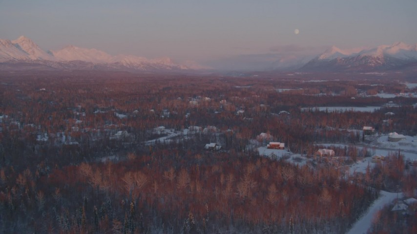 4K stock footage aerial video over snow covered homes, Walby Lake, reveal mountains, Palmer, Alaska, twilight Aerial Stock Footage | AK0001_2093
