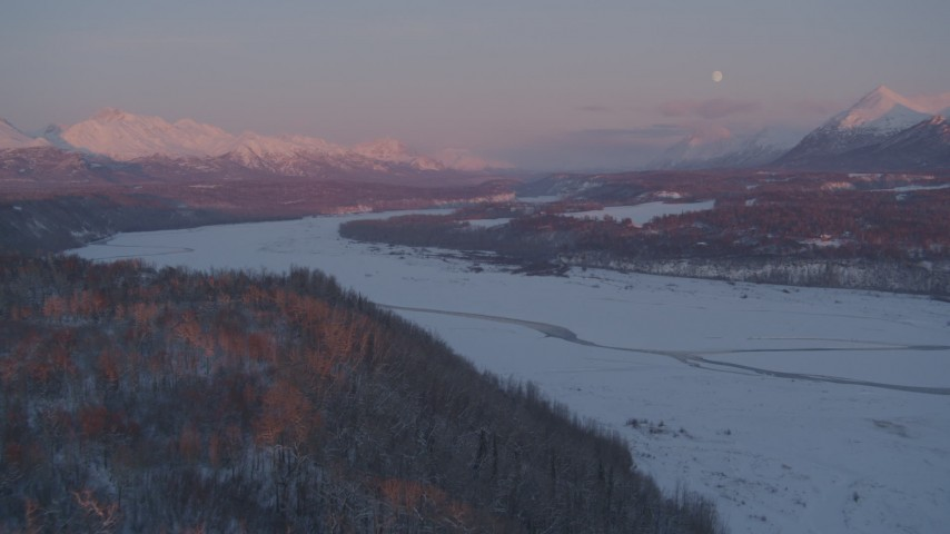4K stock footage aerial video snowy Matanuska River Valley, Chugach Mountains, Palmer, Alaska, twilight Aerial Stock Footage AK0001_2097 | Axiom Images