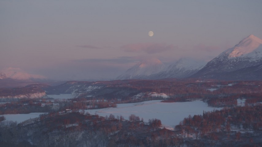 4K stock footage aerial video the moon over the snow covered Chugach Mountains at twilight, Palmer, Alaska Aerial Stock Footage | AK0001_2098