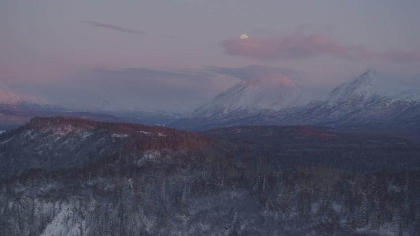 4K stock footage aerial video snowy Chugach Mountains, moon, Matanuska River Valley, Alaska, twilight Aerial Stock Footage | AK0001_2103
