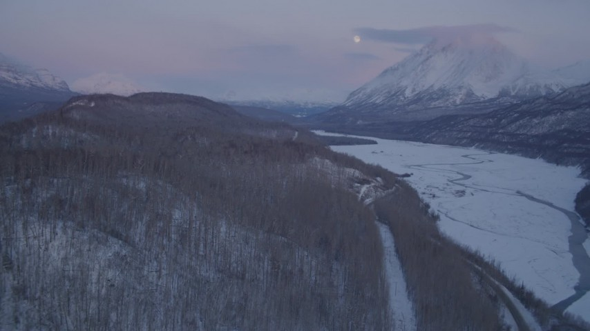 4K stock footage aerial video reveal snowy Matanuska River Valley, Chugach Mountains at sunset, Alaska Aerial Stock Footage | AK0001_2110