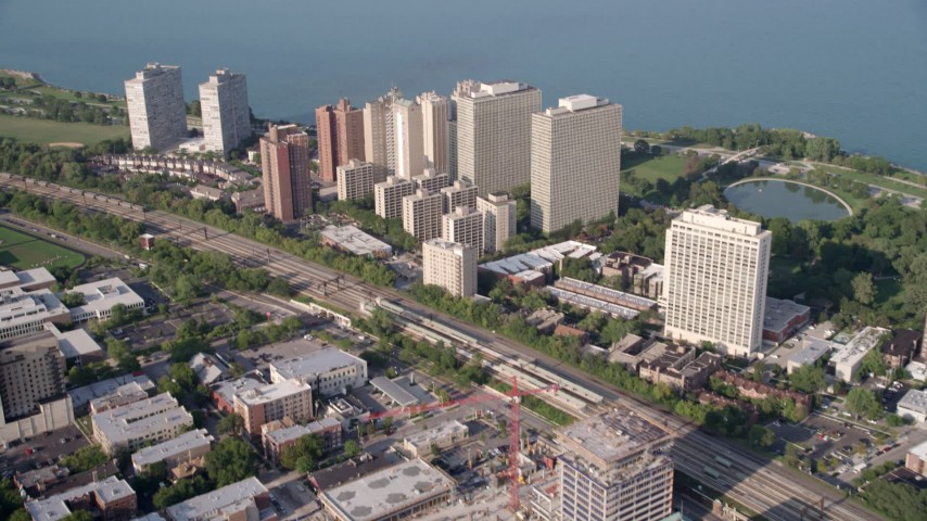 5K stock footage aerial video tilt from train tracks, revealing Hyde Park apartment buildings, Chicago, Illinois Aerial Stock Footage | AX0001_011