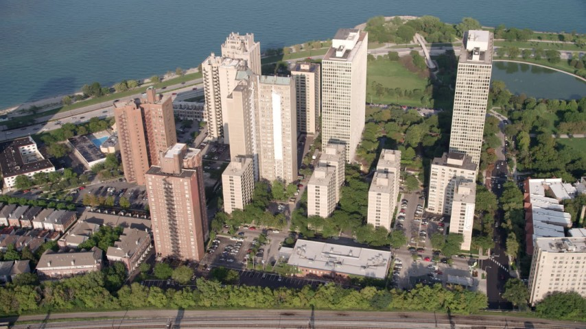 5K stock footage aerial video passing a group of lakefront apartment buildings in Hyde Park, Chicago, Illinois Aerial Stock Footage | AX0001_012