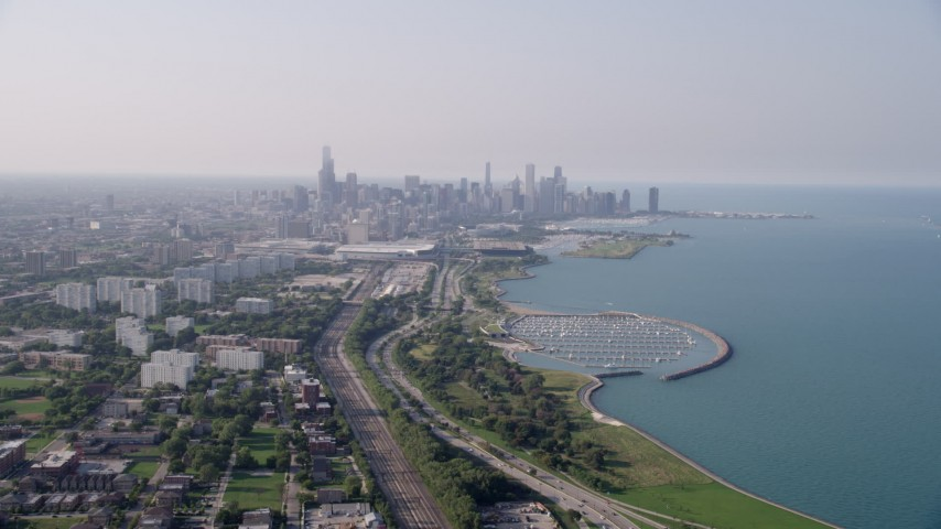 5K stock footage aerial video of the Downtown Chicago skyline and Lake Michigan, on a hazy day, Illinois Aerial Stock Footage | AX0001_014