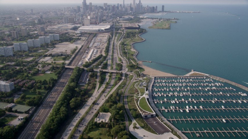 5K stock footage aerial video tilt from 31st Street Harbor and Highway 41, revealing Downtown Chicago skyline, on a hazy day, Illinois Aerial Stock Footage | AX0001_016