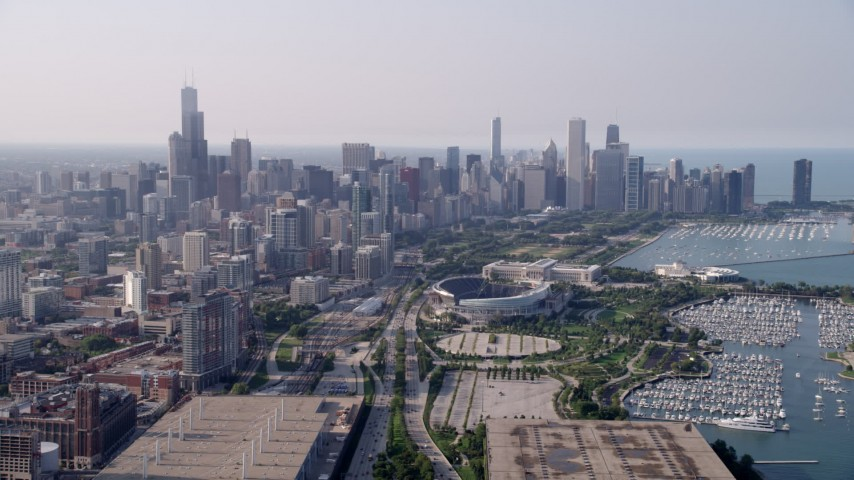 5K stock footage aerial video following Highway 41 toward Soldier Field and Downtown Chicago skyline, on a hazy day, Illinois Aerial Stock Footage | AX0001_019