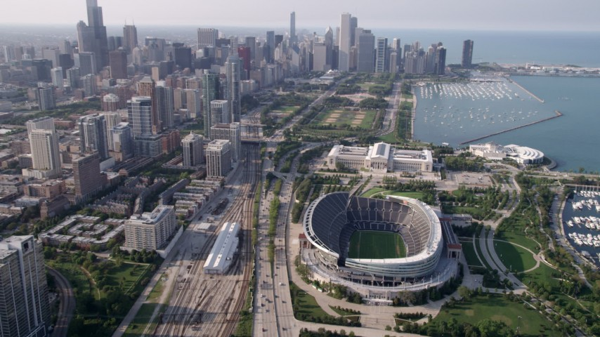 5K stock footage aerial video approach Downtown Chicago and tilt down on Soldier Field, Illinois Aerial Stock Footage | AX0001_021