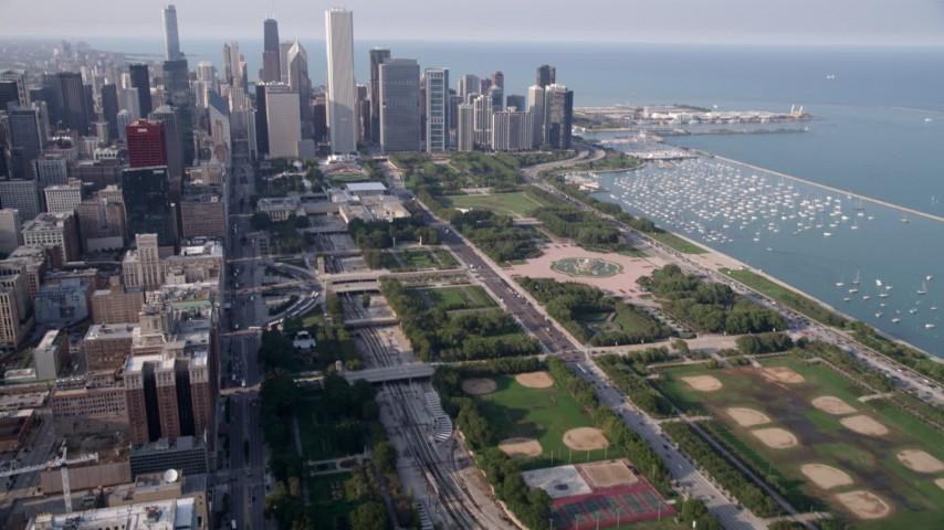 5K stock footage aerial video tilt from One Museum Park, revealing Grant Park and Downtown Chicago skyscrapers, on a hazy day, Illinois Aerial Stock Footage | AX0001_023