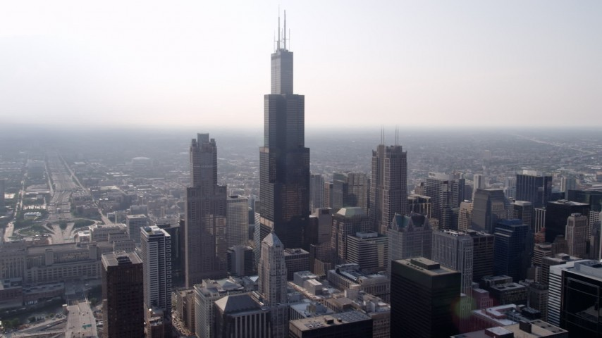 5K stock footage aerial video flying by the Willis Tower, Downtown Chicago, Illinois Aerial Stock Footage | AX0001_025