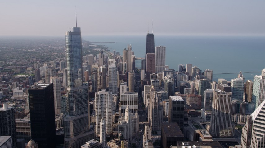 5K aerial video flying over downtown toward Trump Tower Chicago and John Hancock Center, Downtown Chicago, Illinois Aerial Stock Footage | AX0001_027