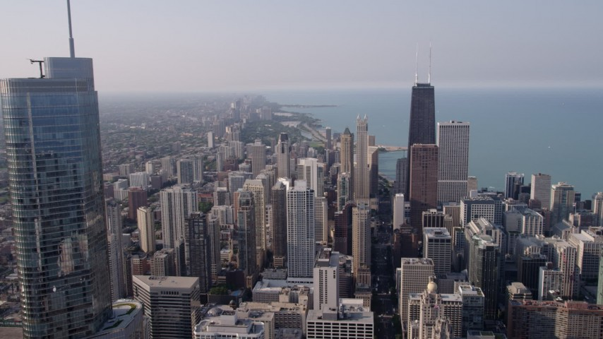 5K aerial video flying past Trump International toward John Hancock Center in Downtown Chicago, Illinois, on a hazy day Aerial Stock Footage | AX0001_028