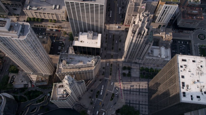 5K stock footage aerial video of a bird's eye view of N Michigan Avenue past Downtown Chicago buildings, Illinois Aerial Stock Footage | AX0001_029
