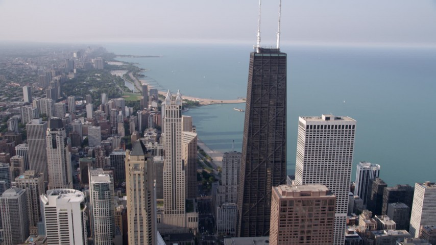 5K stock footage aerial video tilt from N Michigan Avenue to reveal John Hancock Center, Downtown Chicago, Illinois Aerial Stock Footage | AX0001_030