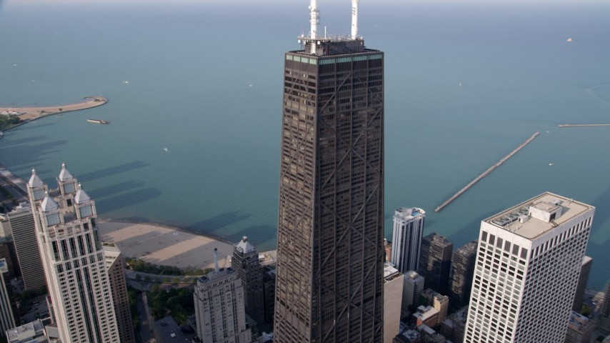 5K aerial video tracking John Hancock Tower, tilt down Downtown Chicago, Illinois Aerial Stock Footage | AX0001_031