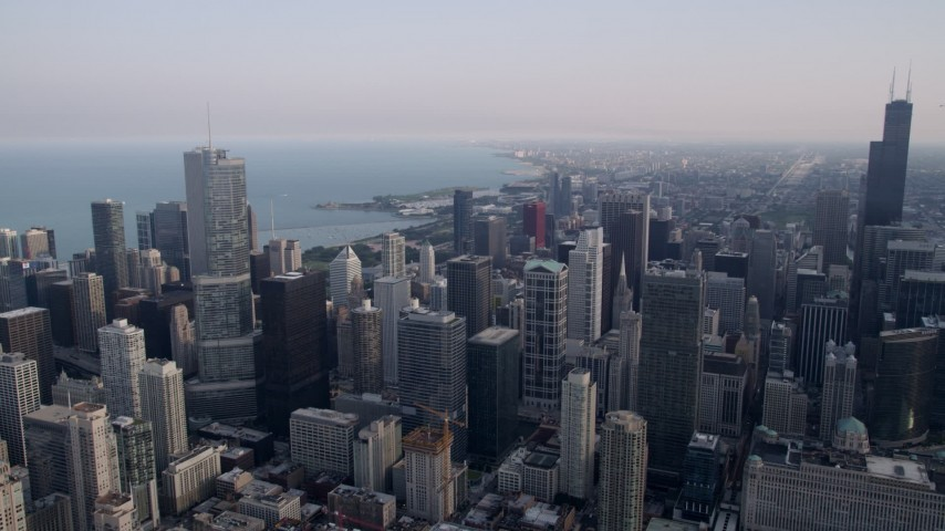 5K stock footage aerial video of Downtown Chicago skyscrapers on a hazy day, Illinois Aerial Stock Footage | AX0001_032