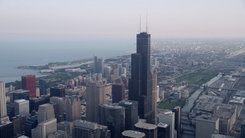 5K aeria video  tilt from the Chicago River to reveal Willis Tower in Downtown Chicago, Illinois Aerial Stock Footage AX0001_033 | Axiom Images