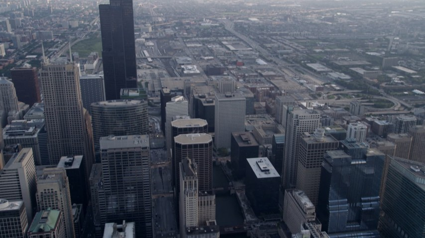 5K aerial video tilt from bird's eye of Chicago River, reveal Willis Tower, Downtown Chicago, Illinois Aerial Stock Footage | AX0001_034