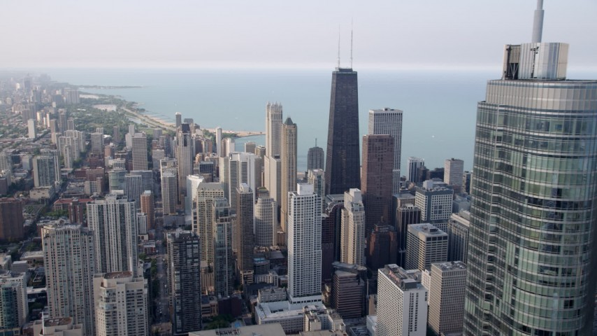 5K stock footage aerial video of John Hancock Center while flying over Downtown Chicago, revealing Trump International, Illinois Aerial Stock Footage | AX0001_035