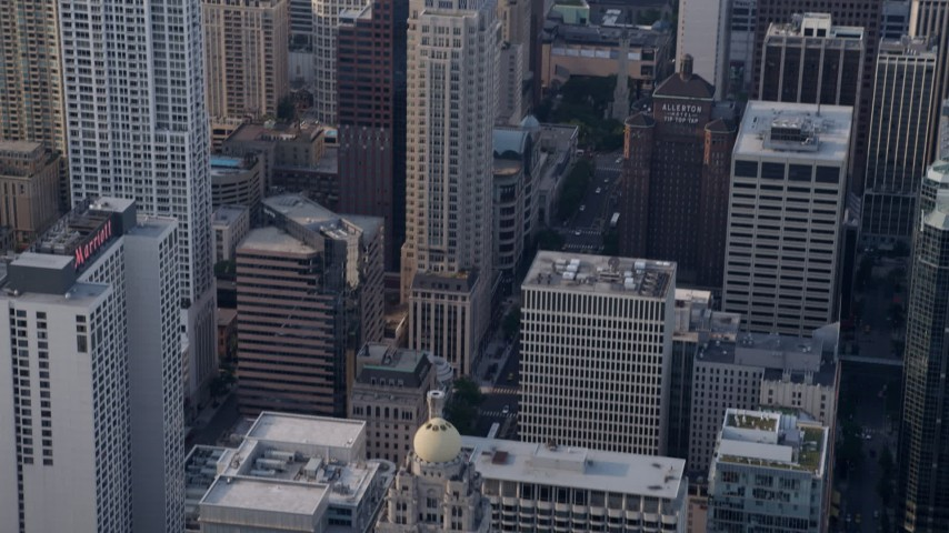 5K stock footage aerial video of tilt down to reveal InterContinental hotel and Tribune Tower in Downtown Chicago, Illinois Aerial Stock Footage | AX0001_036