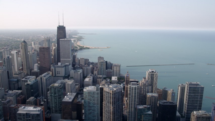 5K aerial video panning across downtown skyscrapers beside Lake Michigan in Downtown Chicago, Illinois Aerial Stock Footage | AX0001_037