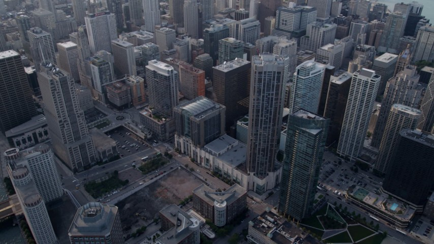 5K stock footage aerial video tilt from Downtown Chicago skyscrapers to Chicago River, on a hazy day, Illinois Aerial Stock Footage | AX0001_038